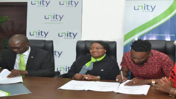 PHOTO NEWS: Unity Bank Signs Adekunle Gold As Brand Ambassador